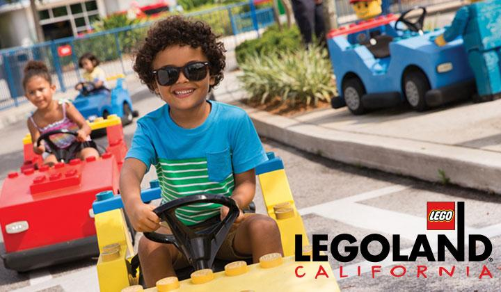 Young child driving Lego car