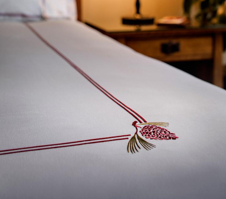 Egyptian cotton linens with signature pine cone made exclusively for The Lodge at Torrey Pines