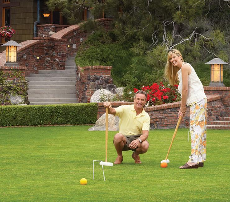 Couple enjoying a round of croquet on the Arroyo Terrace
