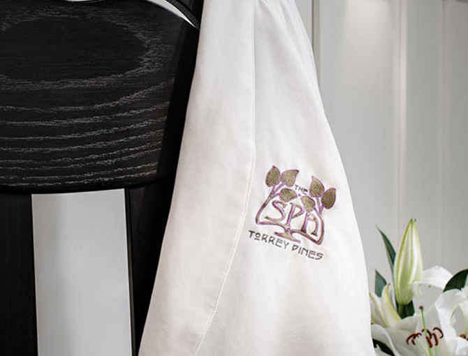 Lodge Torrey Pines Spa  branded robe over a chair