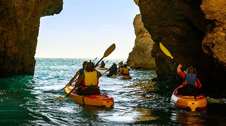 Kayakers in sea cave