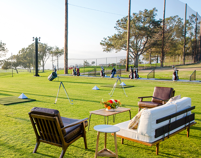 Seating area overlooking driving range Sip n Swing