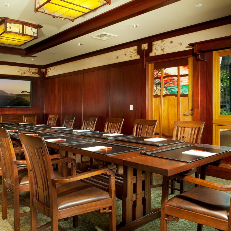 Interior of the Hughes Cottage at The Lodge at Torrey Pines set up for a boardroom style meeting.