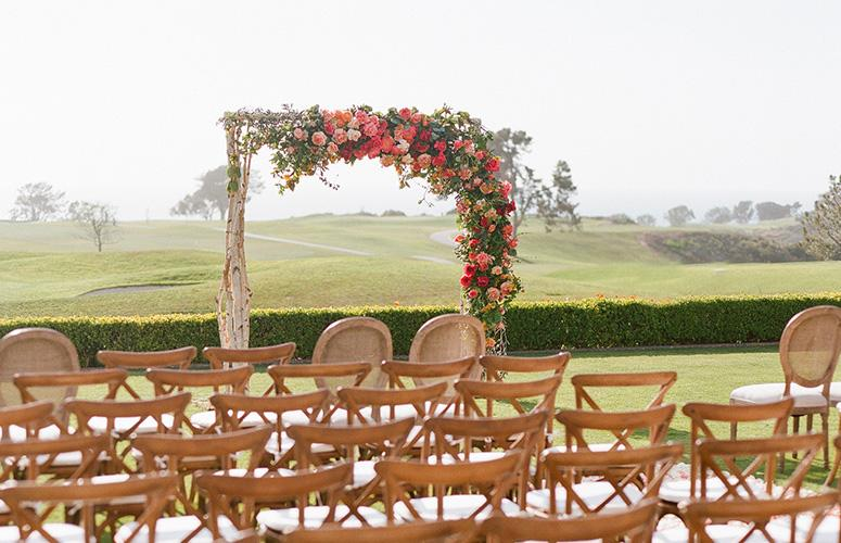 Chairs and arch set up on the Arroyo Terrace at the Lodge at Torrey Pines