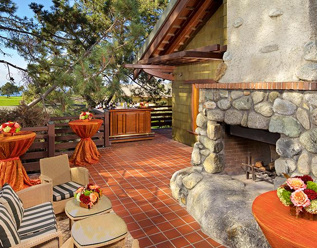 Charles Fries outdoor reception patio with fireplace at The Lodge at Torrey Pines