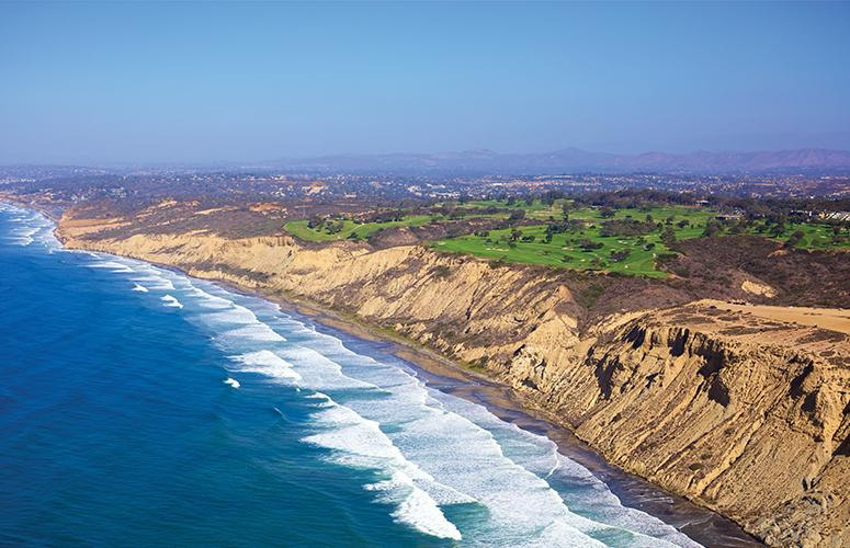 Aerial view of Torrey Pines Golf Course overlooking the pacific ocean.