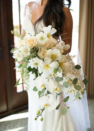 Bride holding bouquet in the suites overlooking the Torrey Pines Golf Course