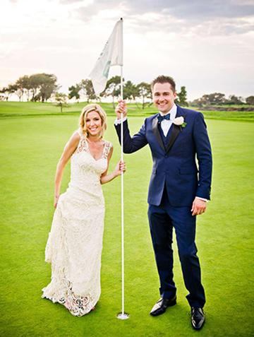 Wedding couple standing on the 18th hole on at the Lodge at Torrey Pines Golf Course