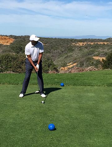 Golfer teeing off at Torrey Pines Golf Course